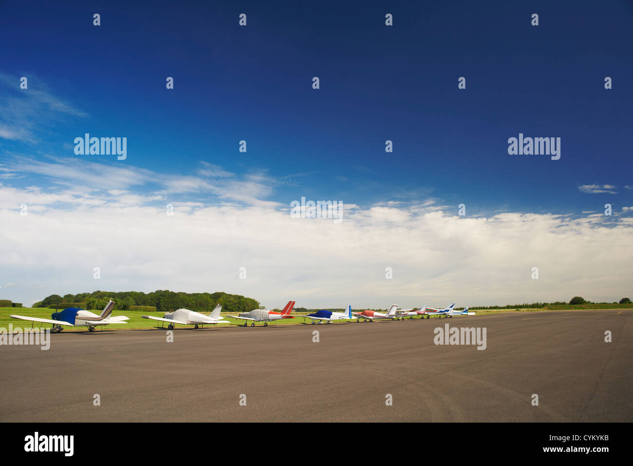 Airplanes parked on airstrip - Stock Image