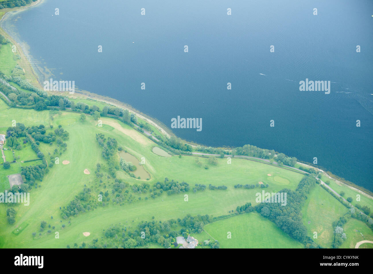 Aerial view of rural fields and lake - Stock Image
