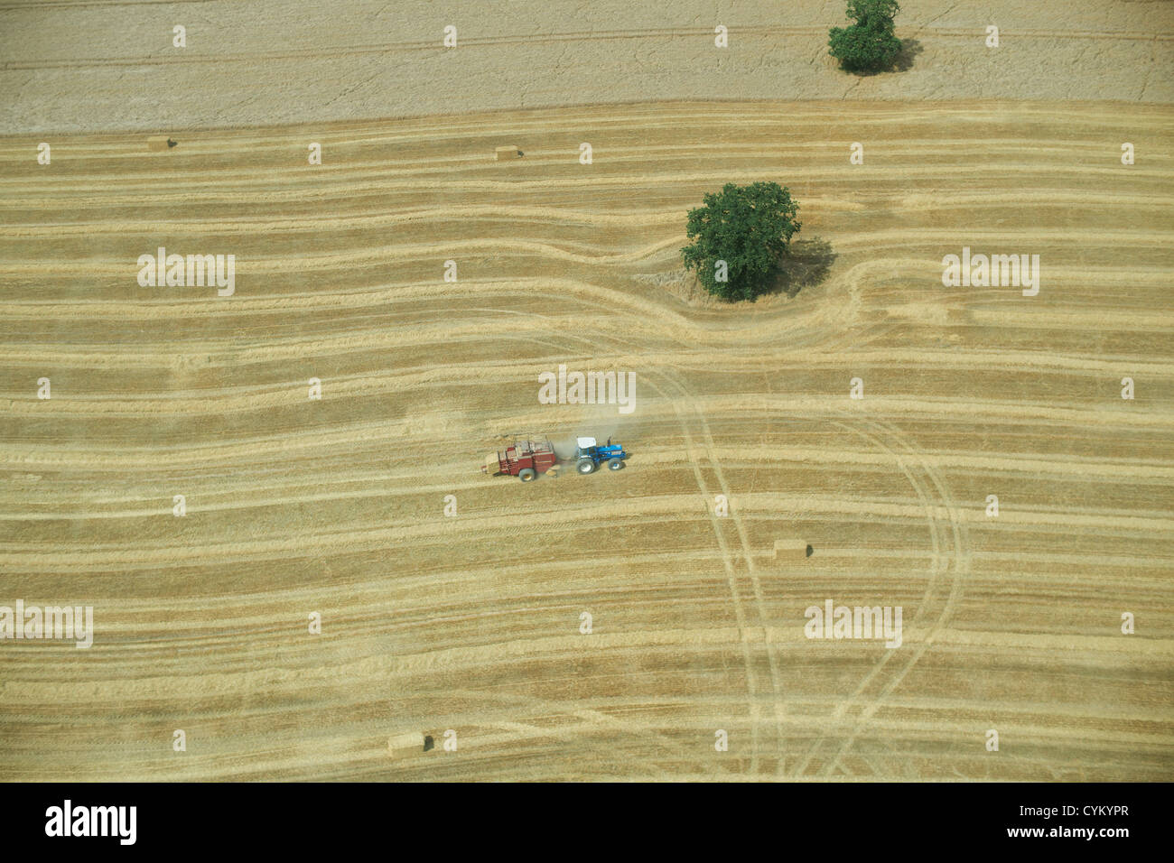 Aerial view of tractor in crop field - Stock Image