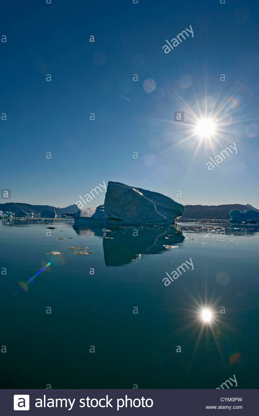 Sun shining over glacial lake - Stock Image