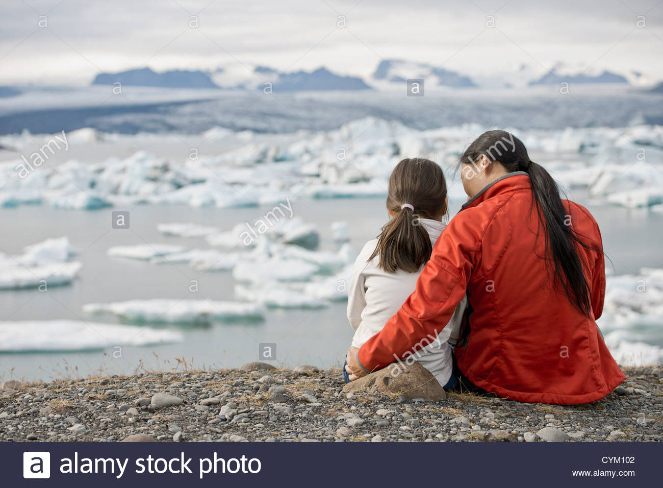 Mother and daughter admiring glaciers - Stock Image