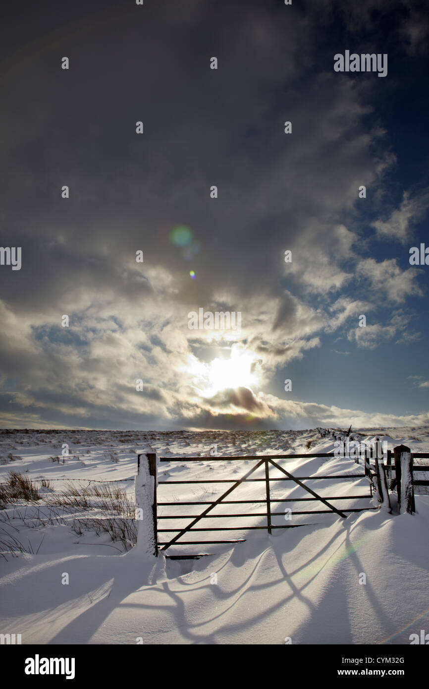 Snow-filled moorland gateway and dramatic sky after heavy snowfall in Nidderdale, North Yorkshire.  Circa December - Stock Image