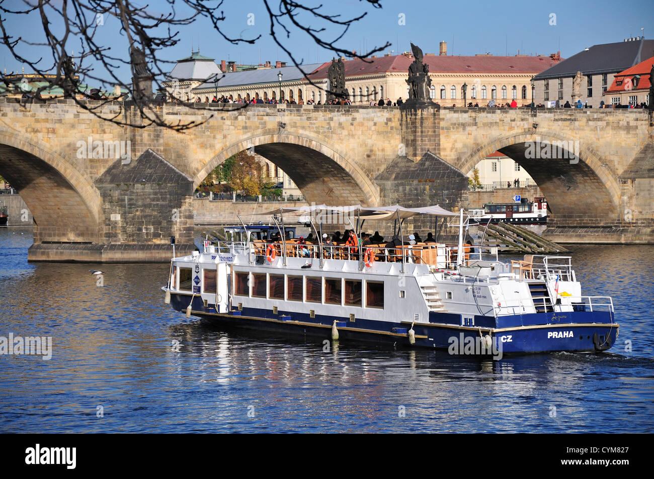 Prague, Czech Republic. Tourist boat on River Vltava (Moldau) - Charles Bridge - Stock Image