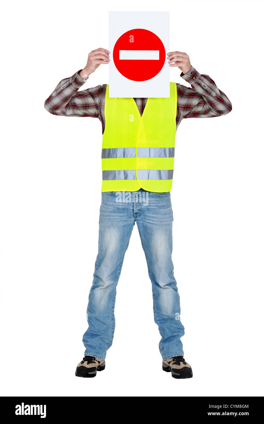 Worker with a No Entry sign - Stock Image