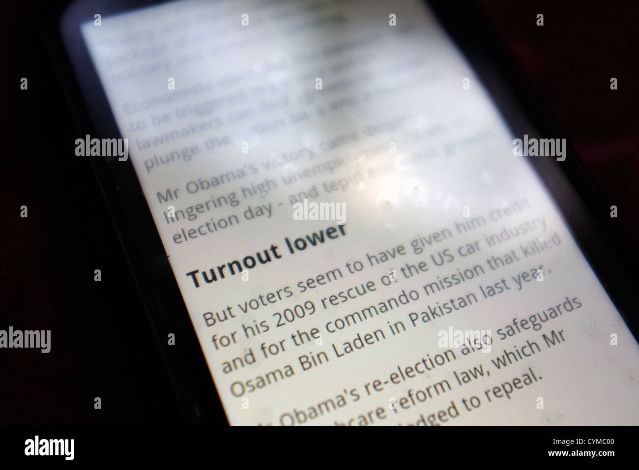 A smartphone screen showing news of lower voter turnout following an election. - Stock Image