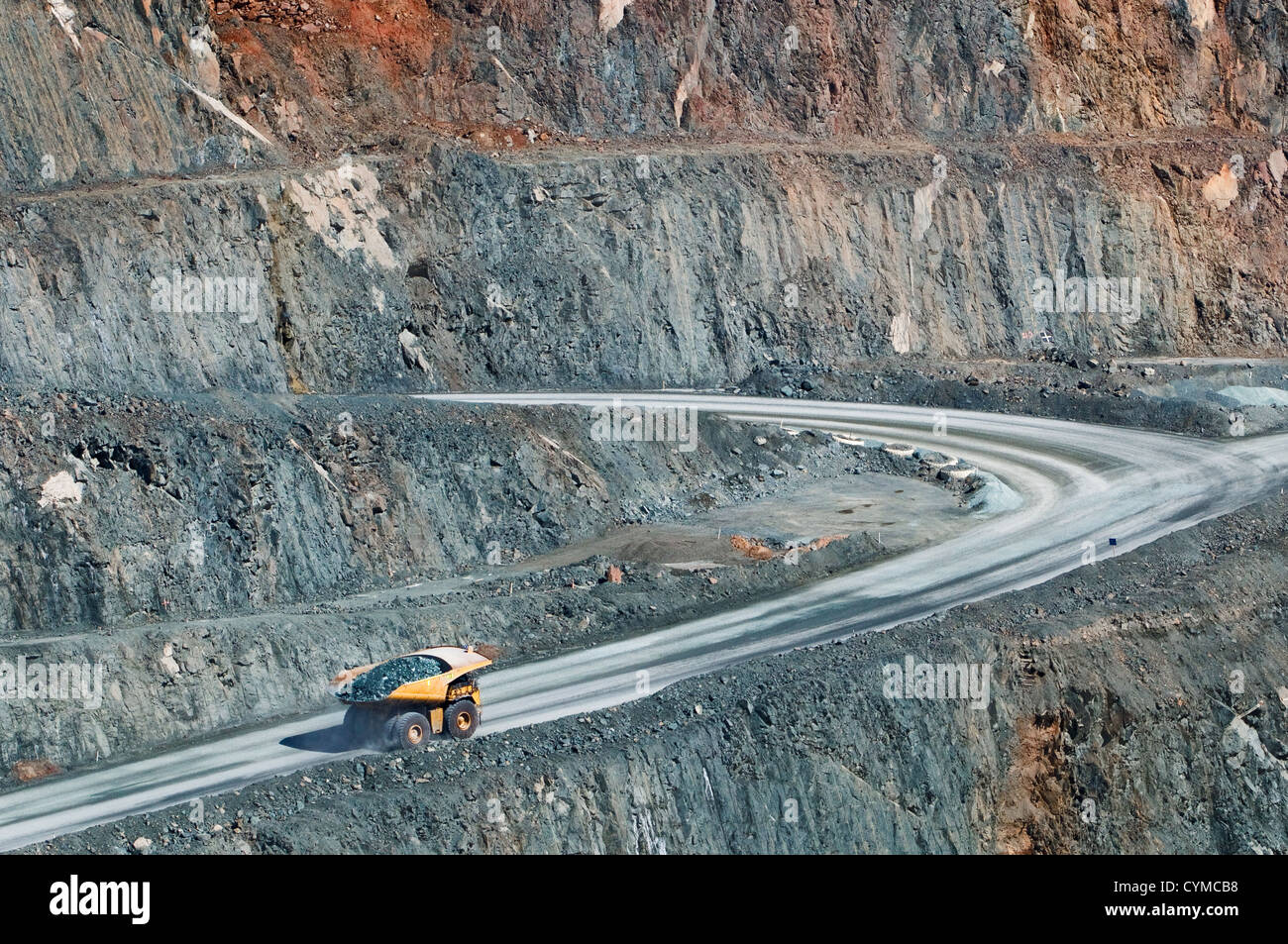 Truck with quarry on its way out of Super Pit. - Stock Image