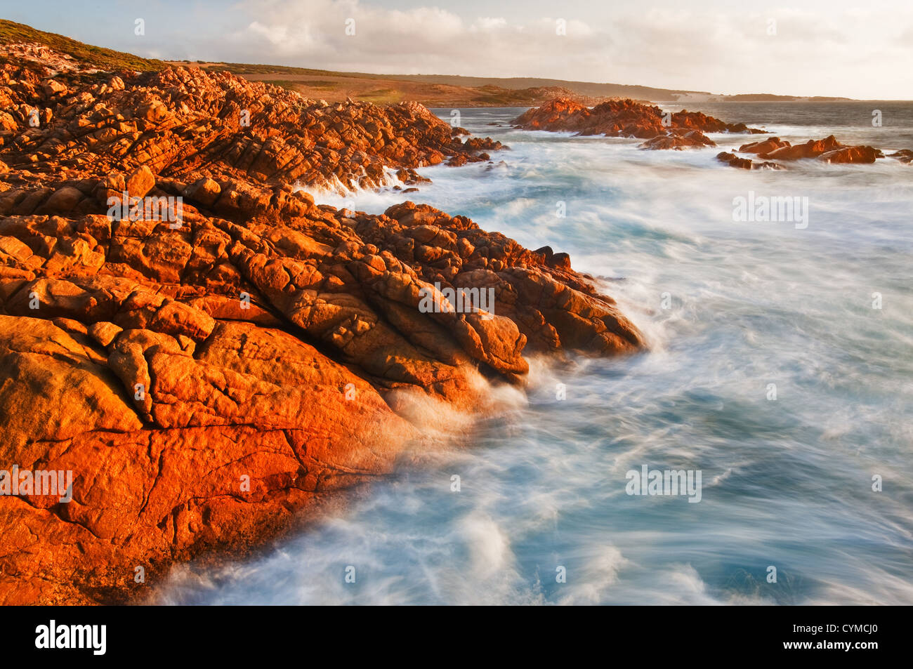 Waves breaking at the rugged coast of Cape Clairault. - Stock Image