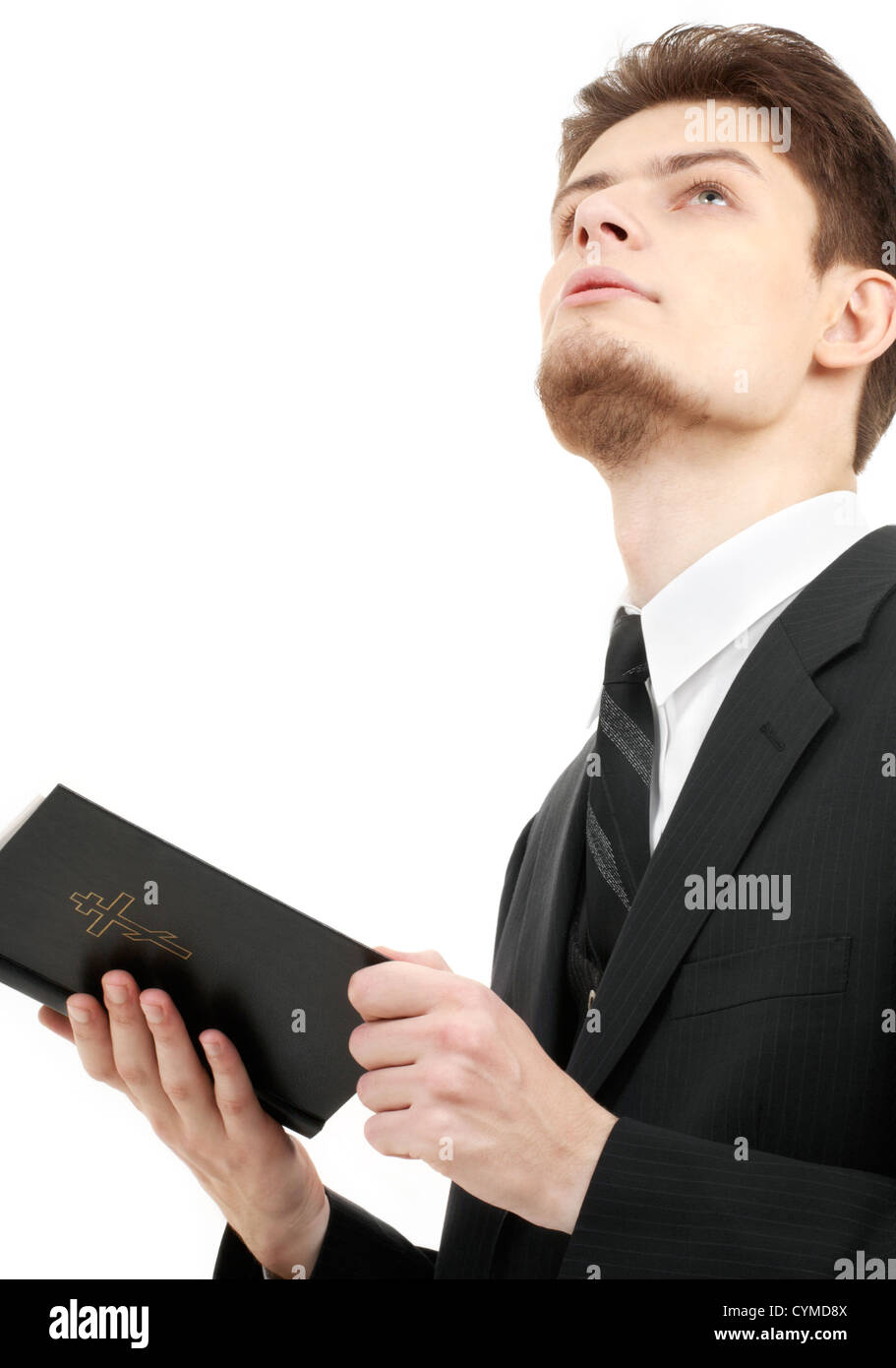 picture of man with holy bible over white - Stock Image