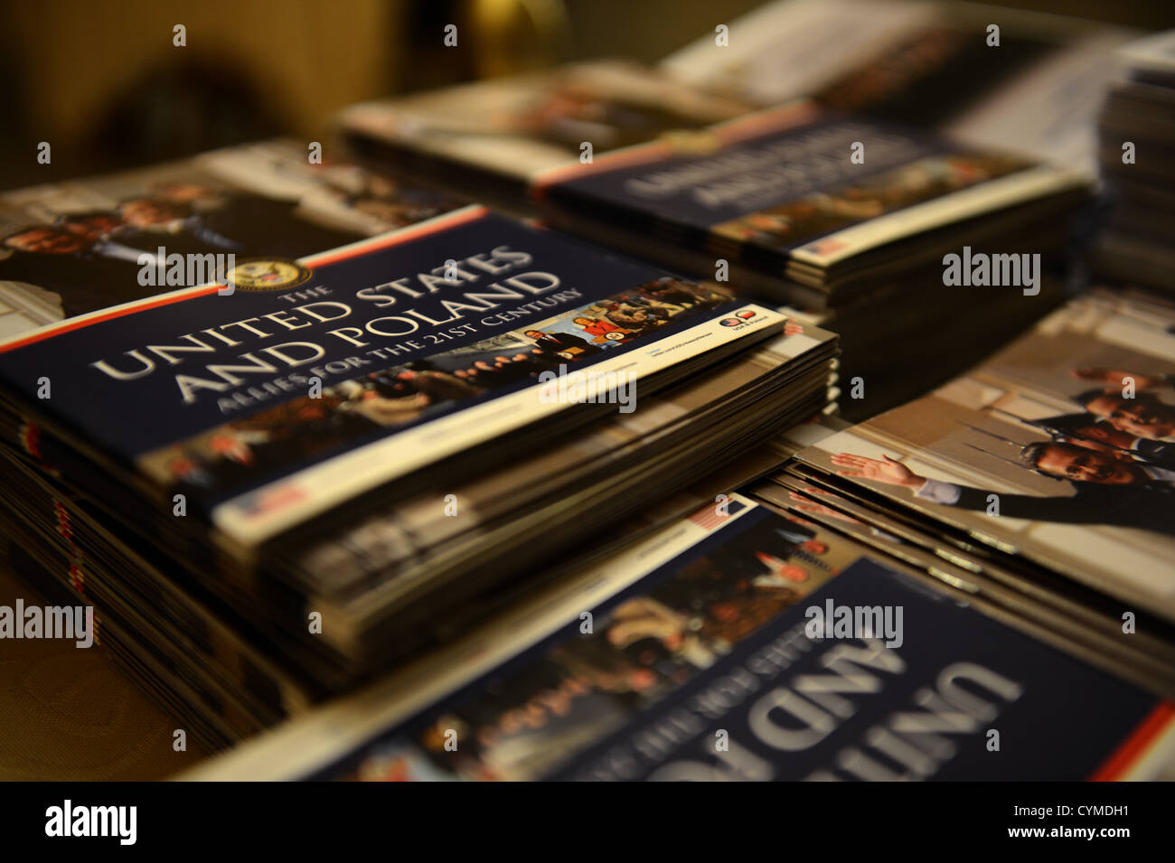RADOM, Poland -- A stack of programs rest on a table during a United States Air Forces in Europe Concert Band performance - Stock Image