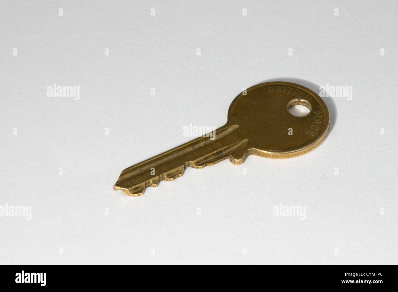 Brass coloured door key - Stock Image