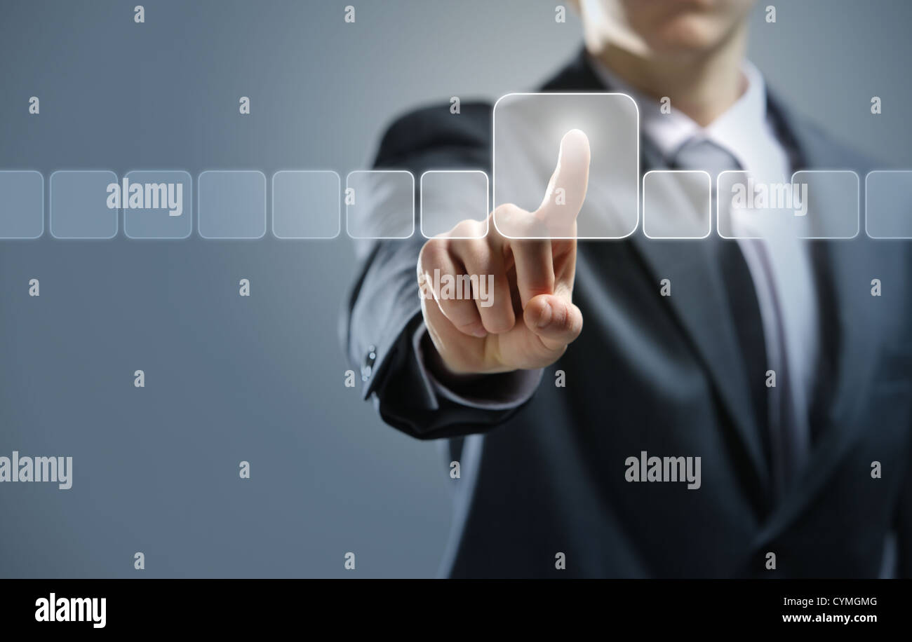 Businessman pressing virtual media type of buttons - Stock Image