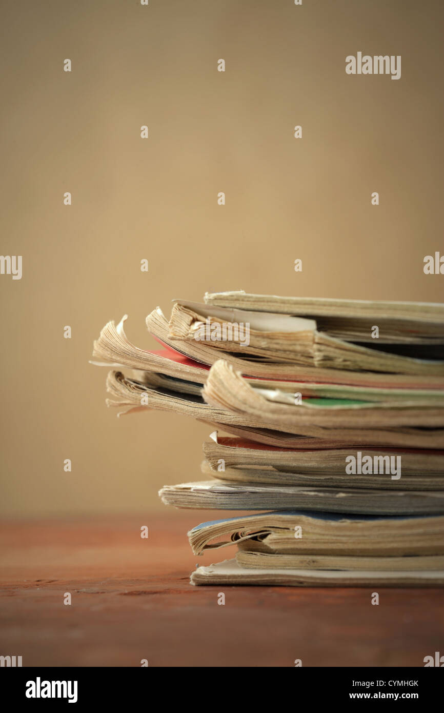 Stack of old magazines, close up Stock Photo