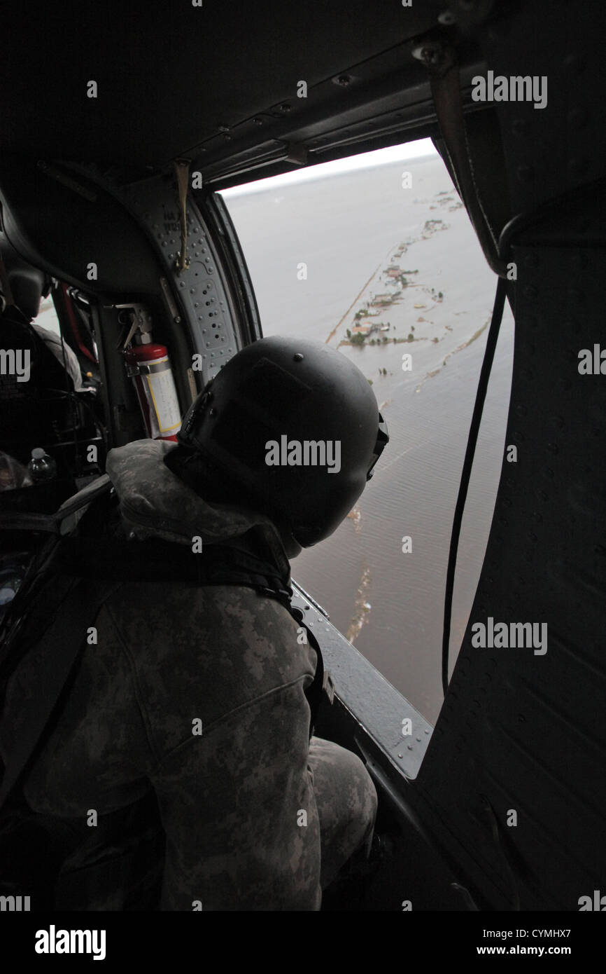 Aviators of the 1-150th Assault Helicopter Battalion, New Jersey Army National Guard, search for stranded New Jersey - Stock Image