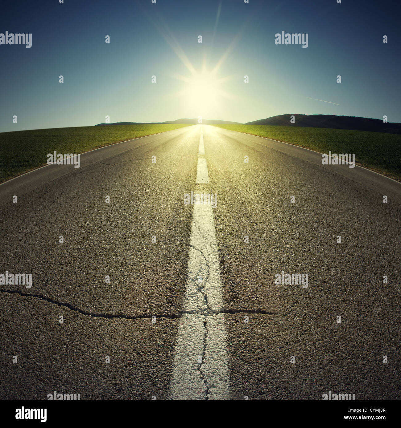 asphalt of country road in backlight - Stock Image