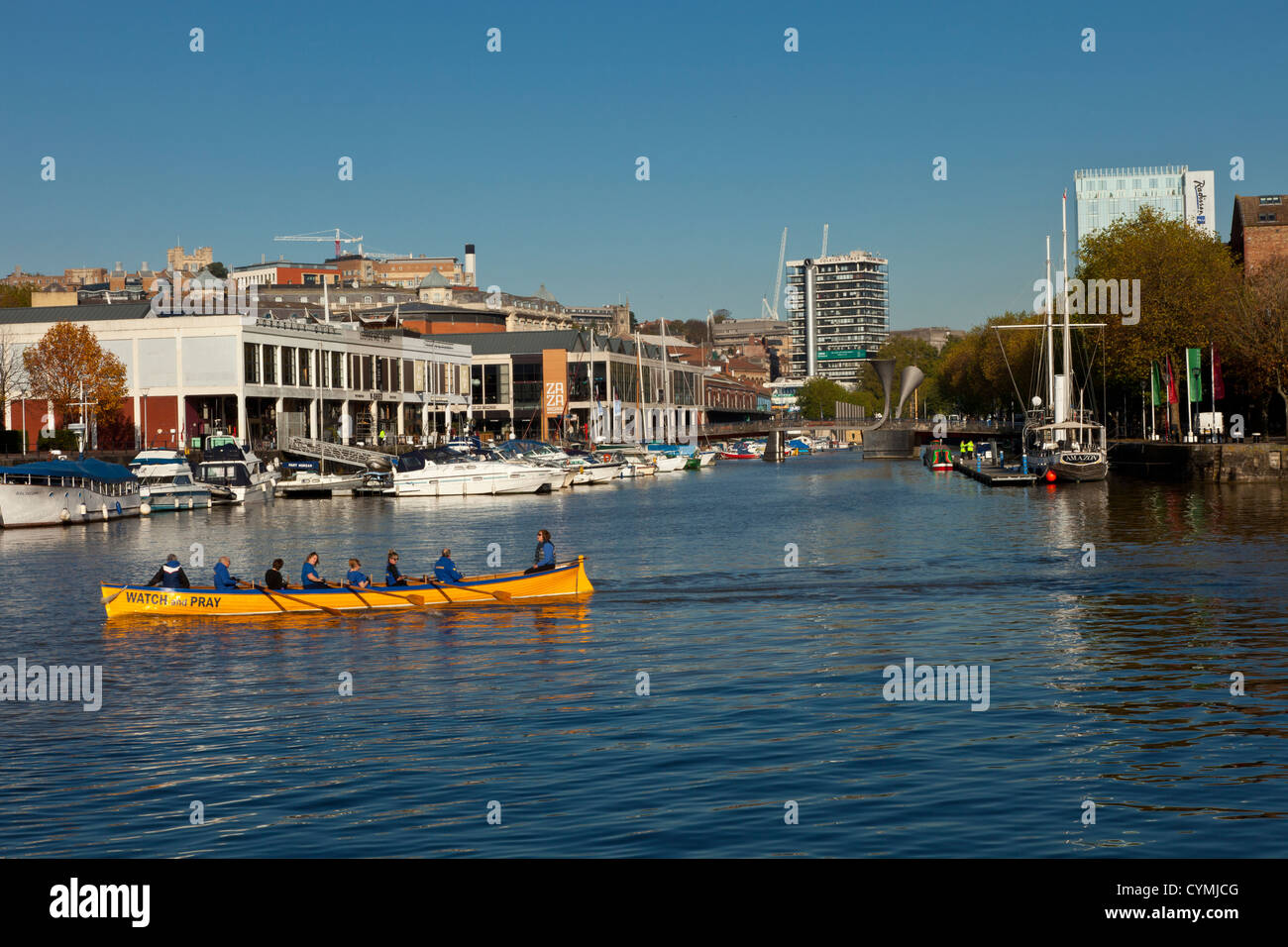 Lady rowers practicing in Bristols floating harbor harbour. - Stock Image