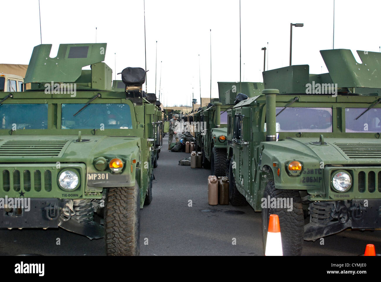 New York Army National Guard soldiers assigned to the 206th Military Police Company prepare to move out on a road Stock Photo