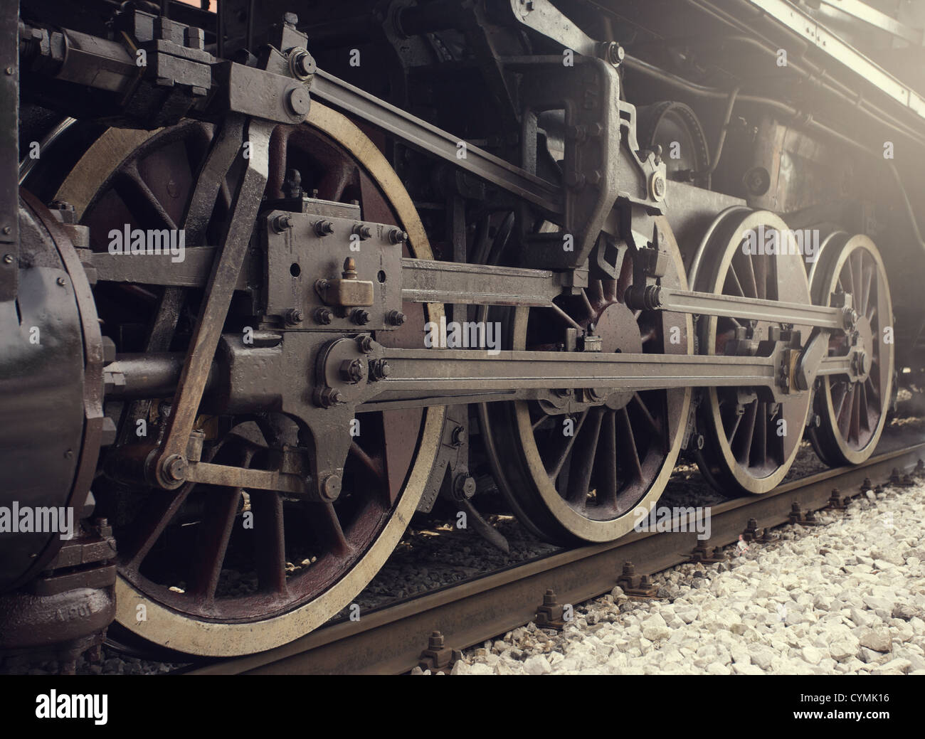 Old locomotive wheels close up. - Stock Image