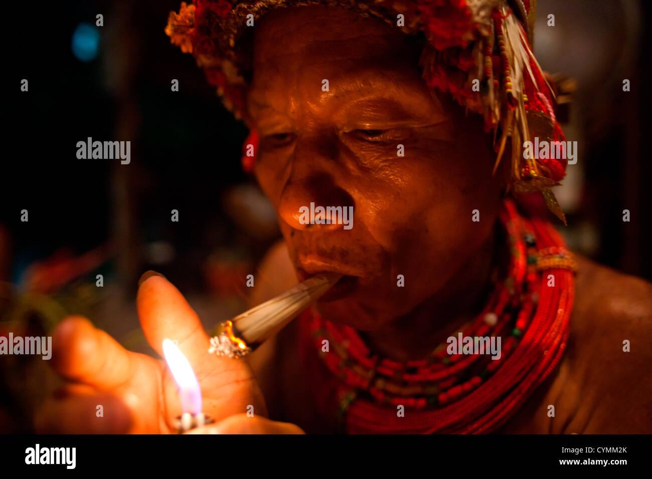 Mentawai Medicine men, covered in tattoos, perform ceremonies for visitors on Kandui Island, including dancing, - Stock Image