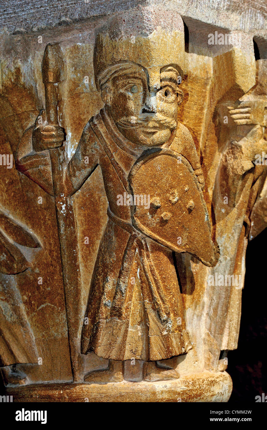 France, Midi-Pyrenees: Romanesque capital in the cloister of Abbey St. Foy in Conques - Stock Image