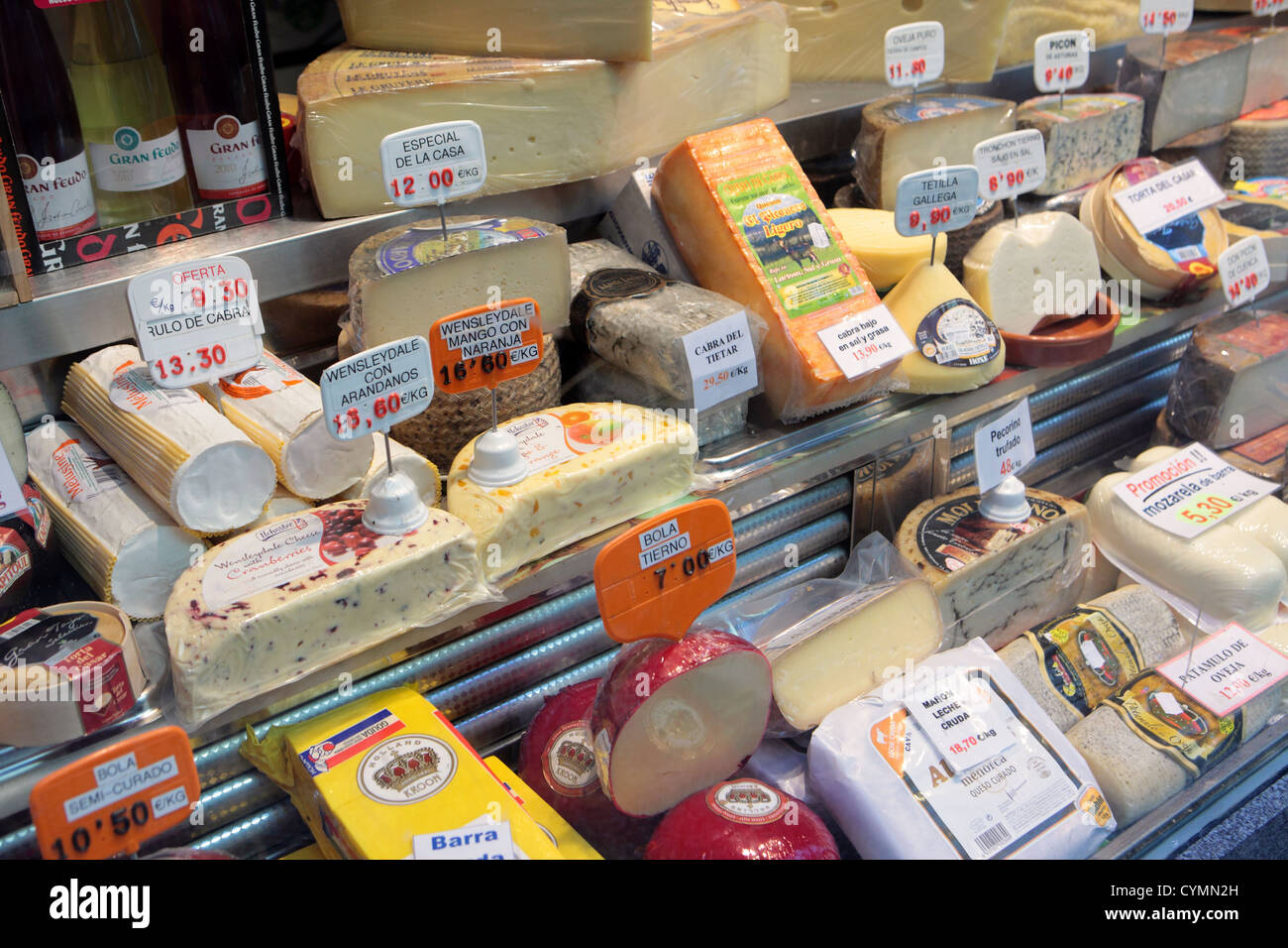 Cheese shop window in central Madrid, showing huge range selection of European cheeses, Spain. Stock Photo