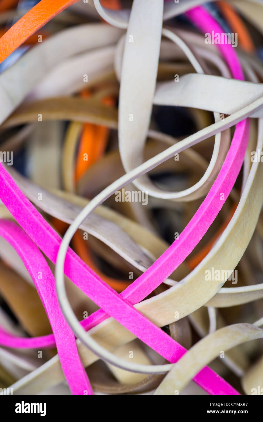 Closeup of pile of rubber bands - Stock Image