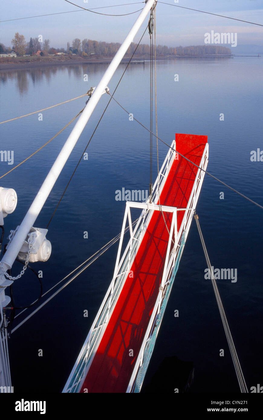 Gangplank to Nowhere -The suspended gangway of a riverboat leads to nowhere as the vessel travels along the Columbia - Stock Image