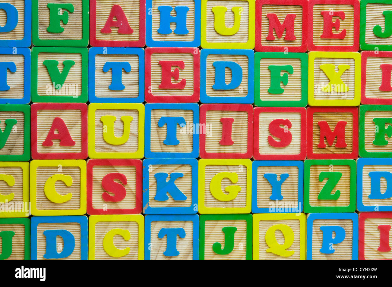 The word Autism made from toy alphabet blocks - Stock Image