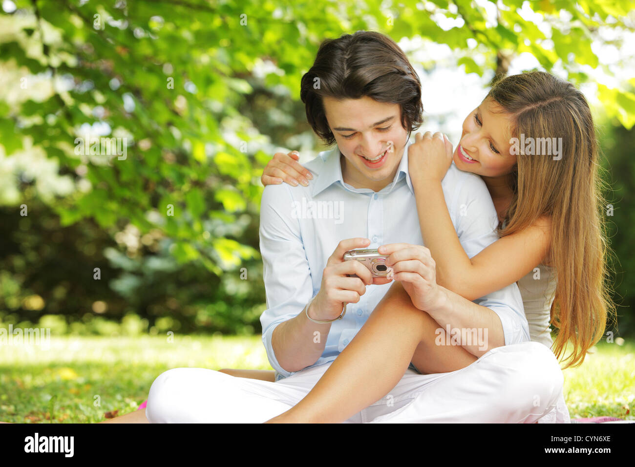 a couple of lovers, view photos on the display of their compact camera - Stock Image