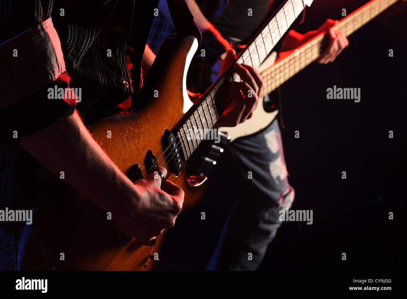 rock musicians playing at a live concert - Stock Image