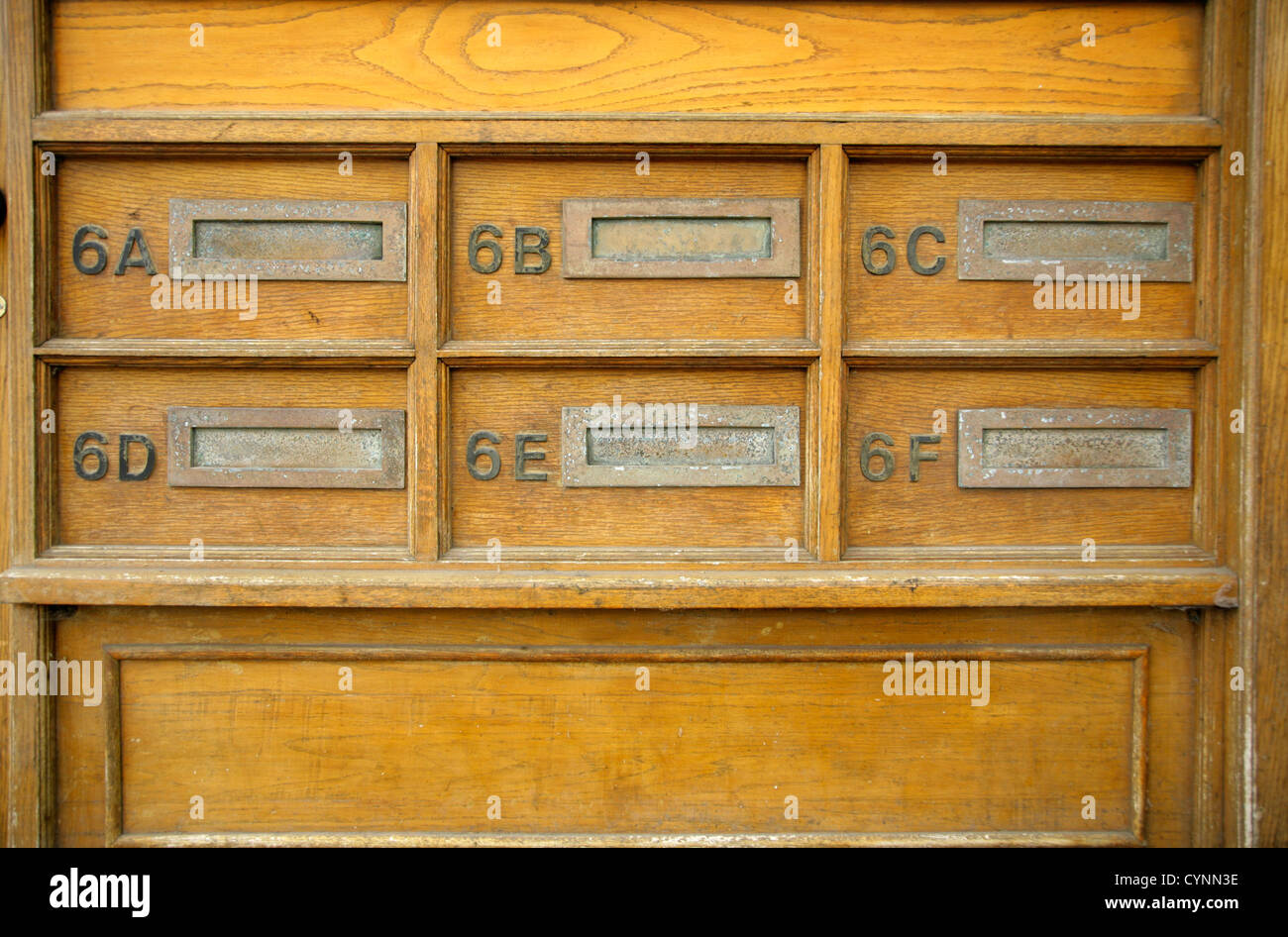 Six postboxes for flats 6A to 6F. - Stock Image