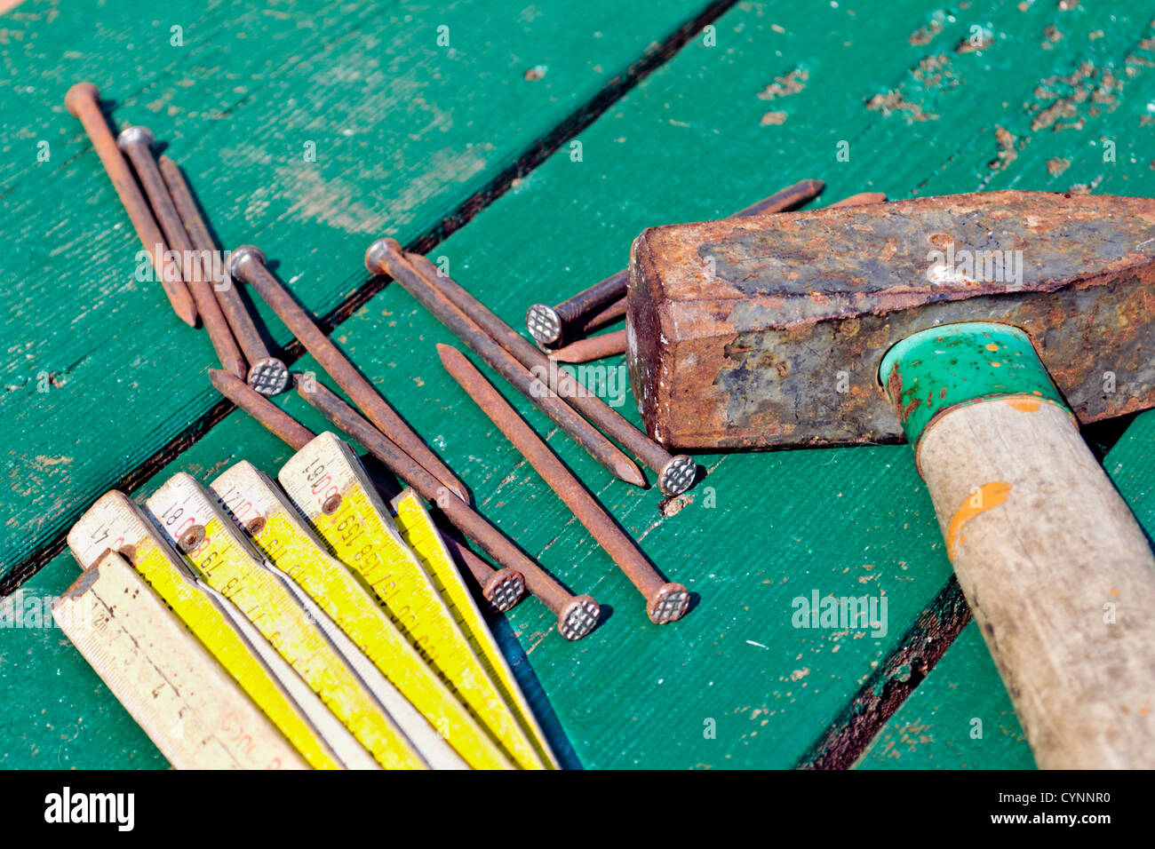 Hammer Nails On Table Stock Photos & Hammer Nails On Table Stock ...