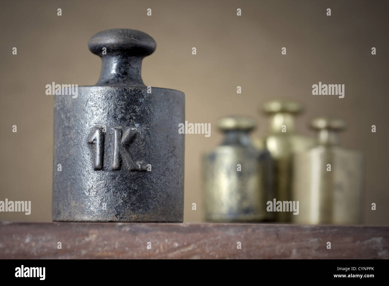 Vintage 1 kilogram calibration iron weight - Stock Image