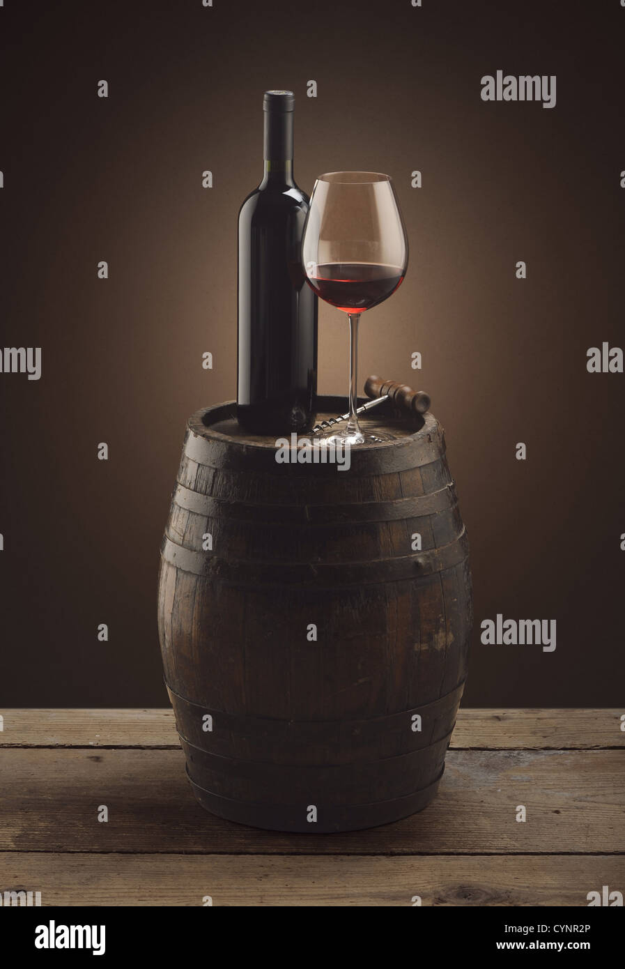red wine bottle and wine glass on wooden barrel - Stock Image