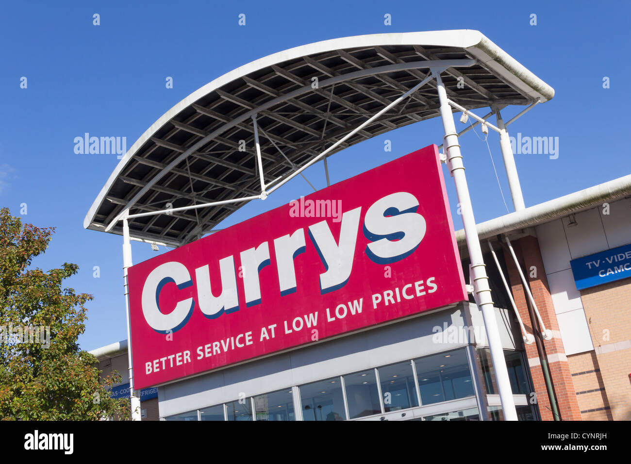 The entrance to Currys electrical appliance retail store on Bolton Gate Retail Park, Bolton. - Stock Image