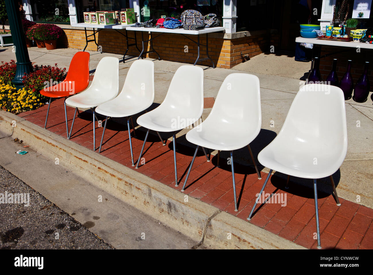 A Row Of Vintage Herman Miller Fiberglass Chairs Lined Up Along A Curb  During Pumpkinfest In Zeeland, Michigan