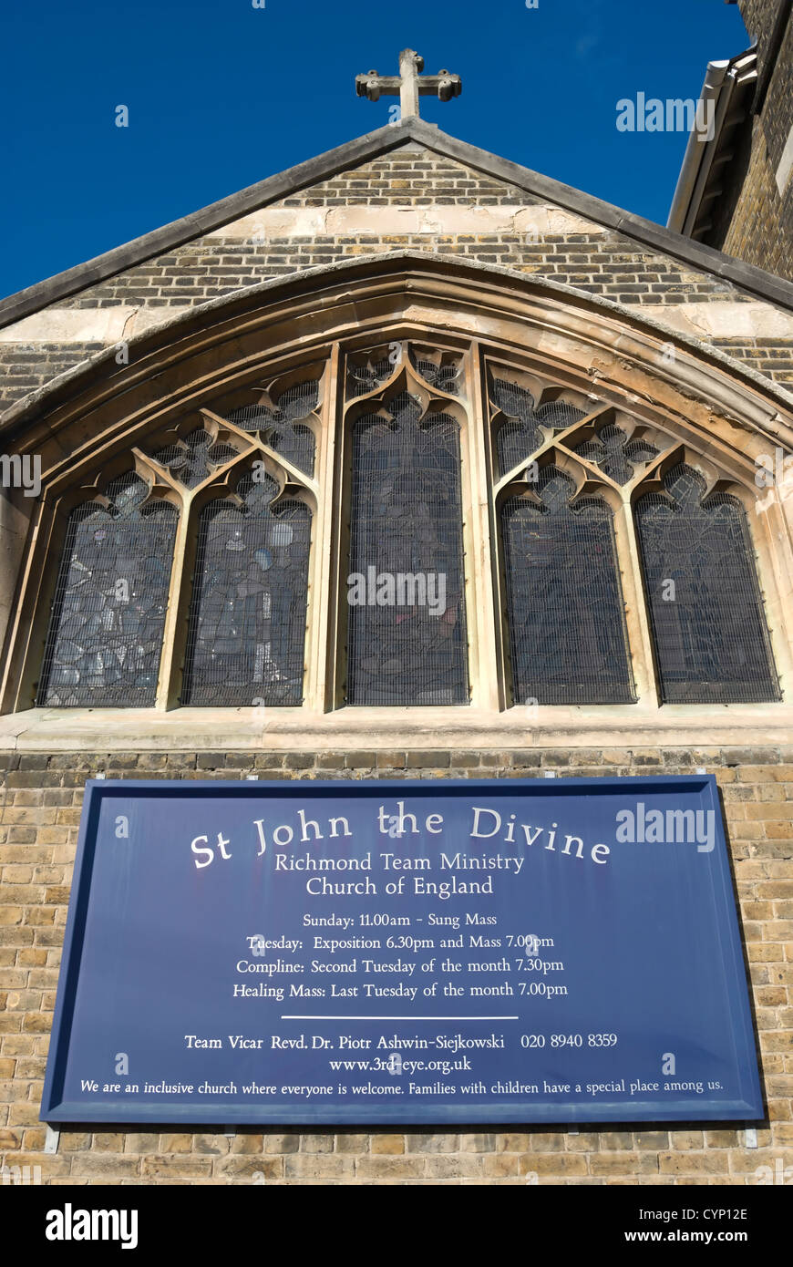 noticeboard with service times and church details at the church of st john the divine, richmond upon thames, surrey, - Stock Image