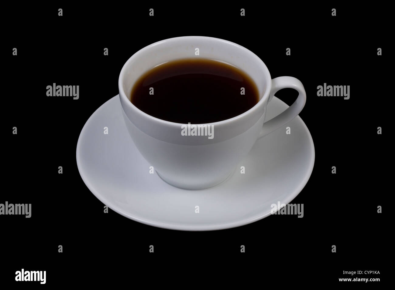 Closeup of a cup of coffee on a black background. - Stock Image
