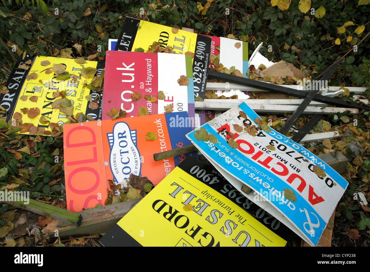 Dumped estate agent property signs - Stock Image