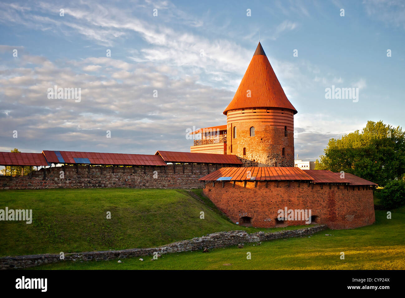 Kaunas city castle in sunset with clouds in the sky. - Stock Image