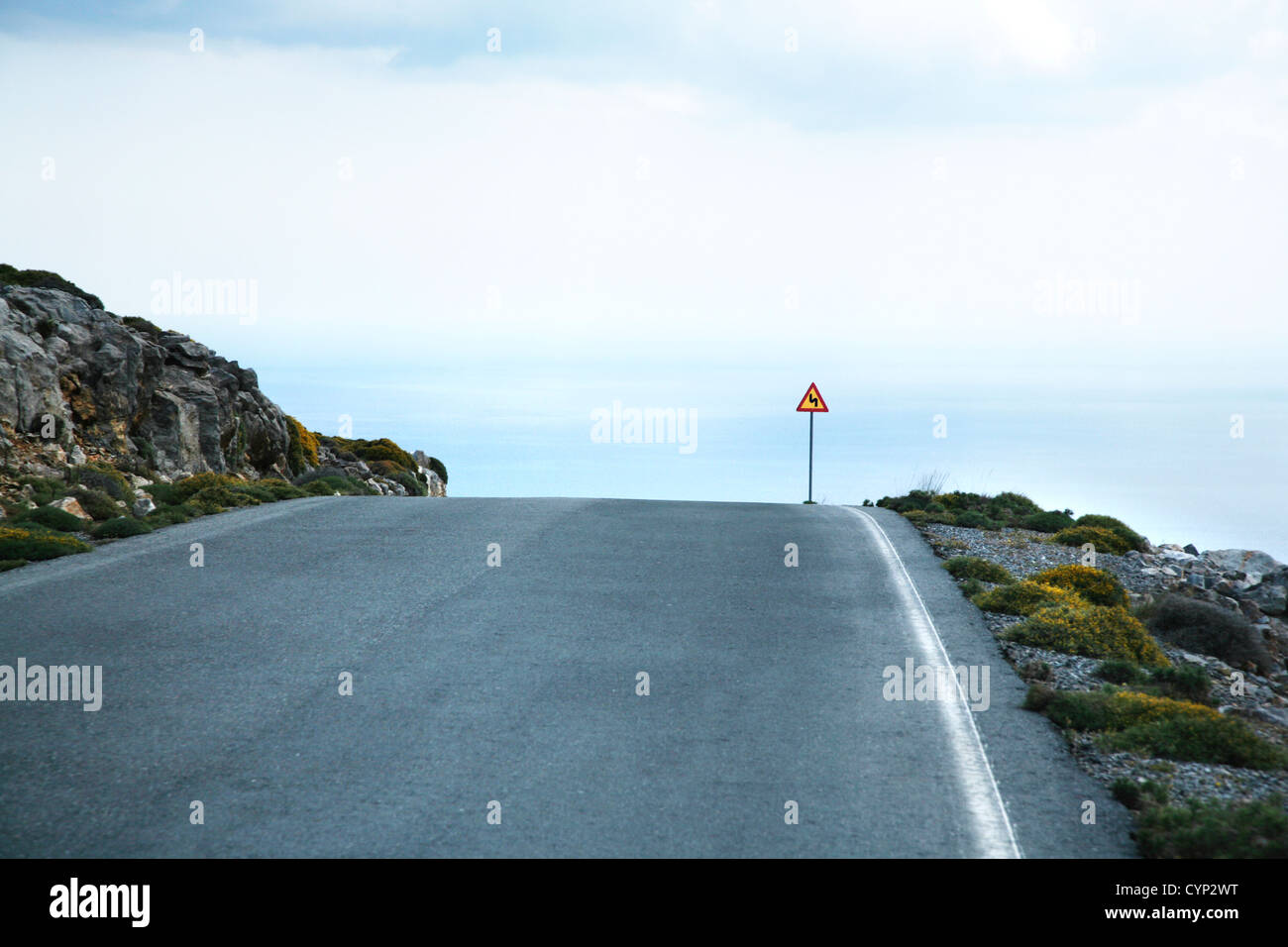 road sign of dangerous curve at crete greece Stock Photo