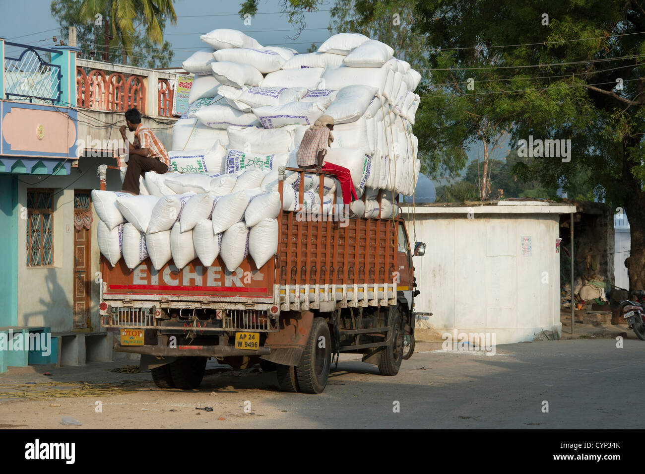 Indian truck overloaded with rice sacks. Andhra Pradesh, India - Stock Image