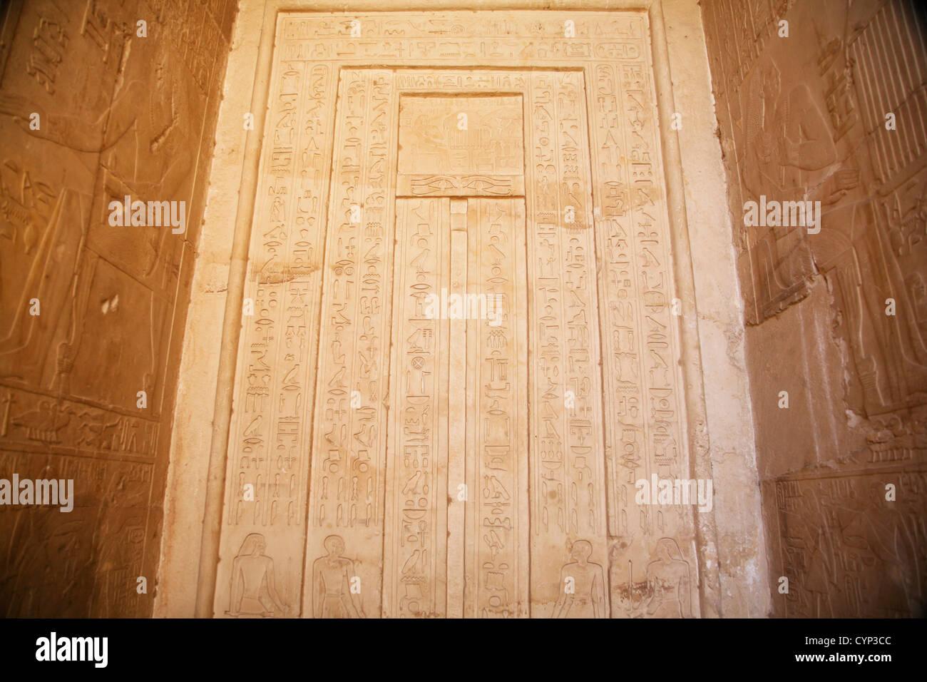 egyptian wall with hieroglyphic writings - Stock Image