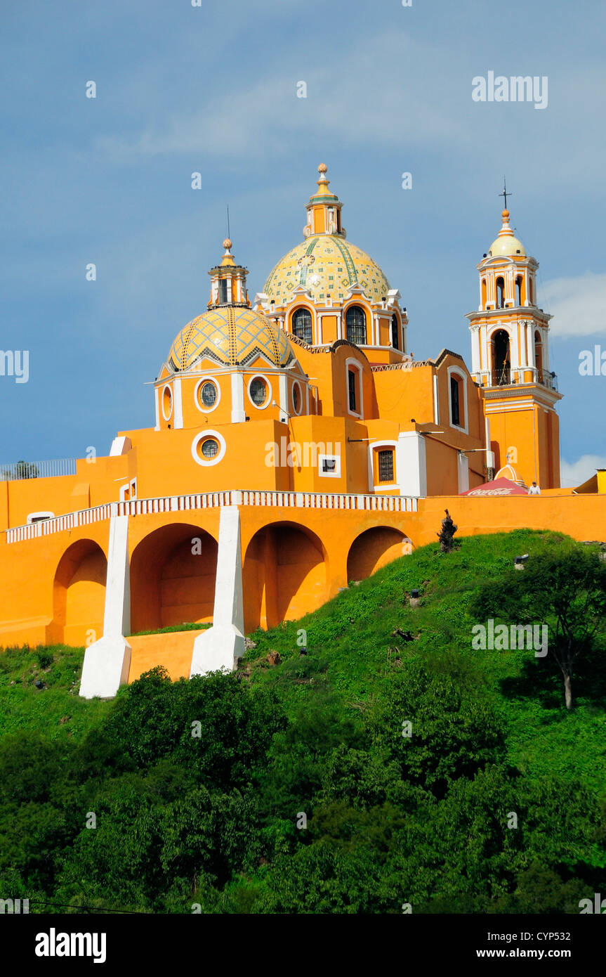 Church of Neustra Senor de los Remedios or Our Lady of Remedios on wooded hillside above the pyramid ruins with - Stock Image