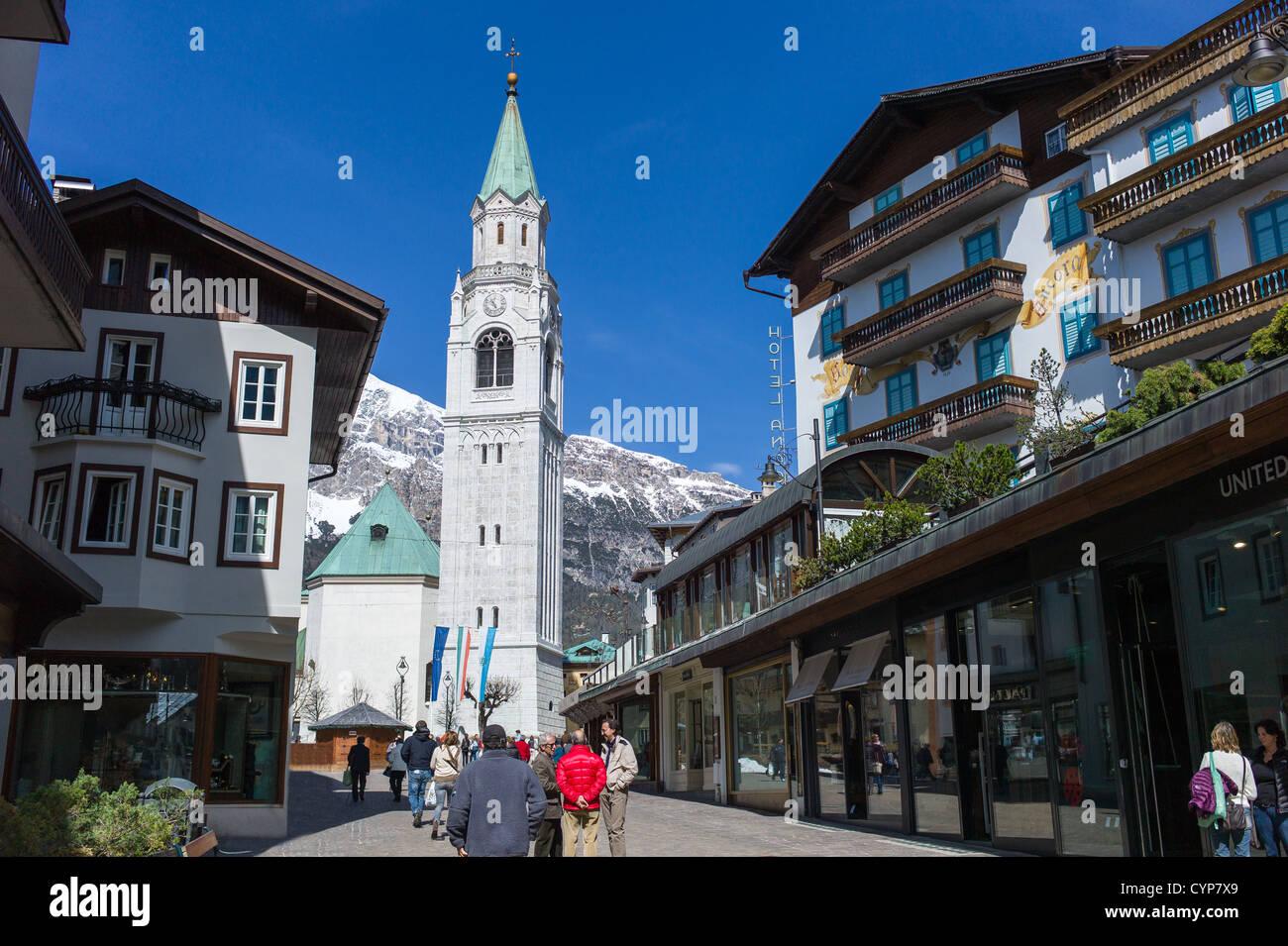 Italy, Dolomites, Veneto, Cortina D'Ampezzo, Corso Italia and the St Filippo and Giacomo parish church - Stock Image