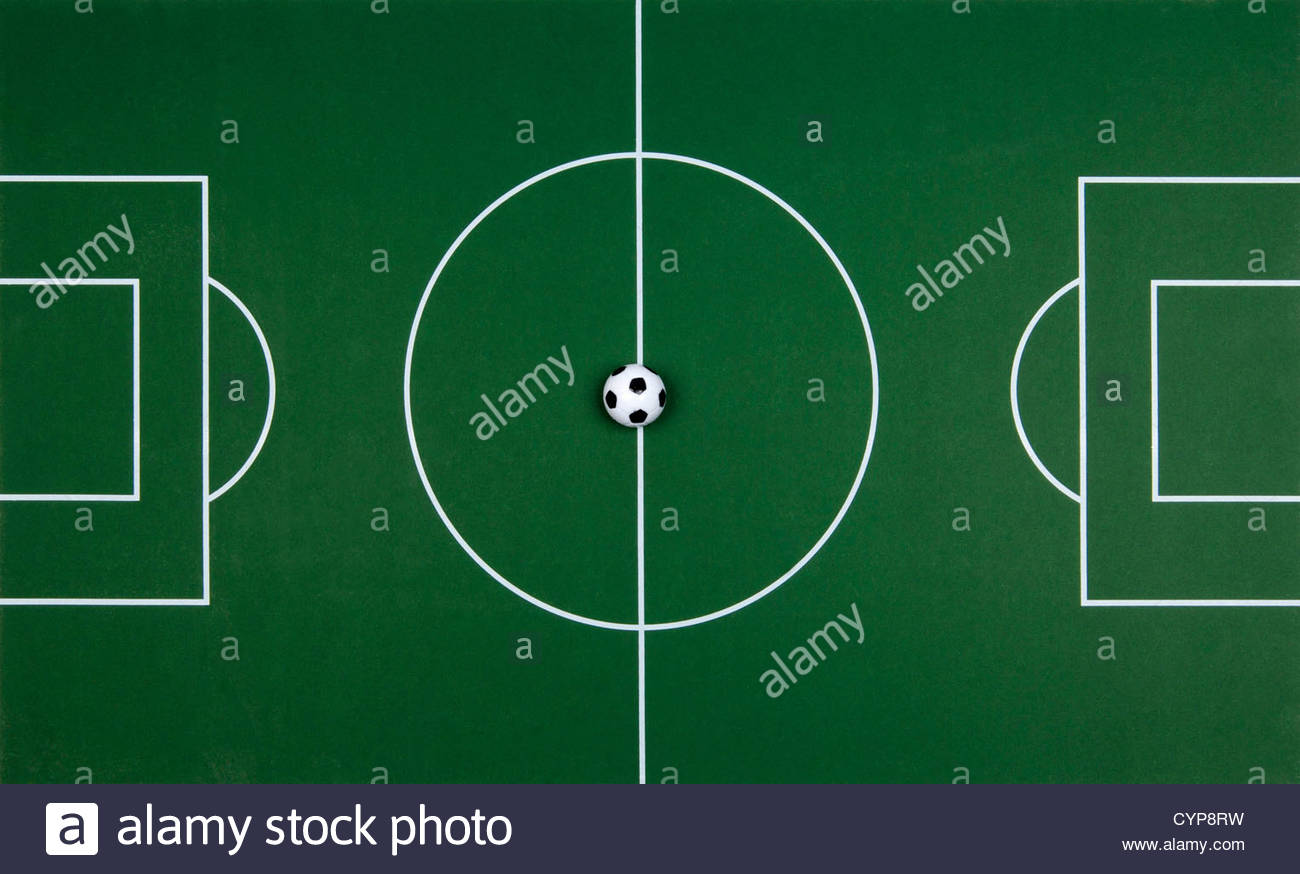 Toy football pitch with small football - Stock Image