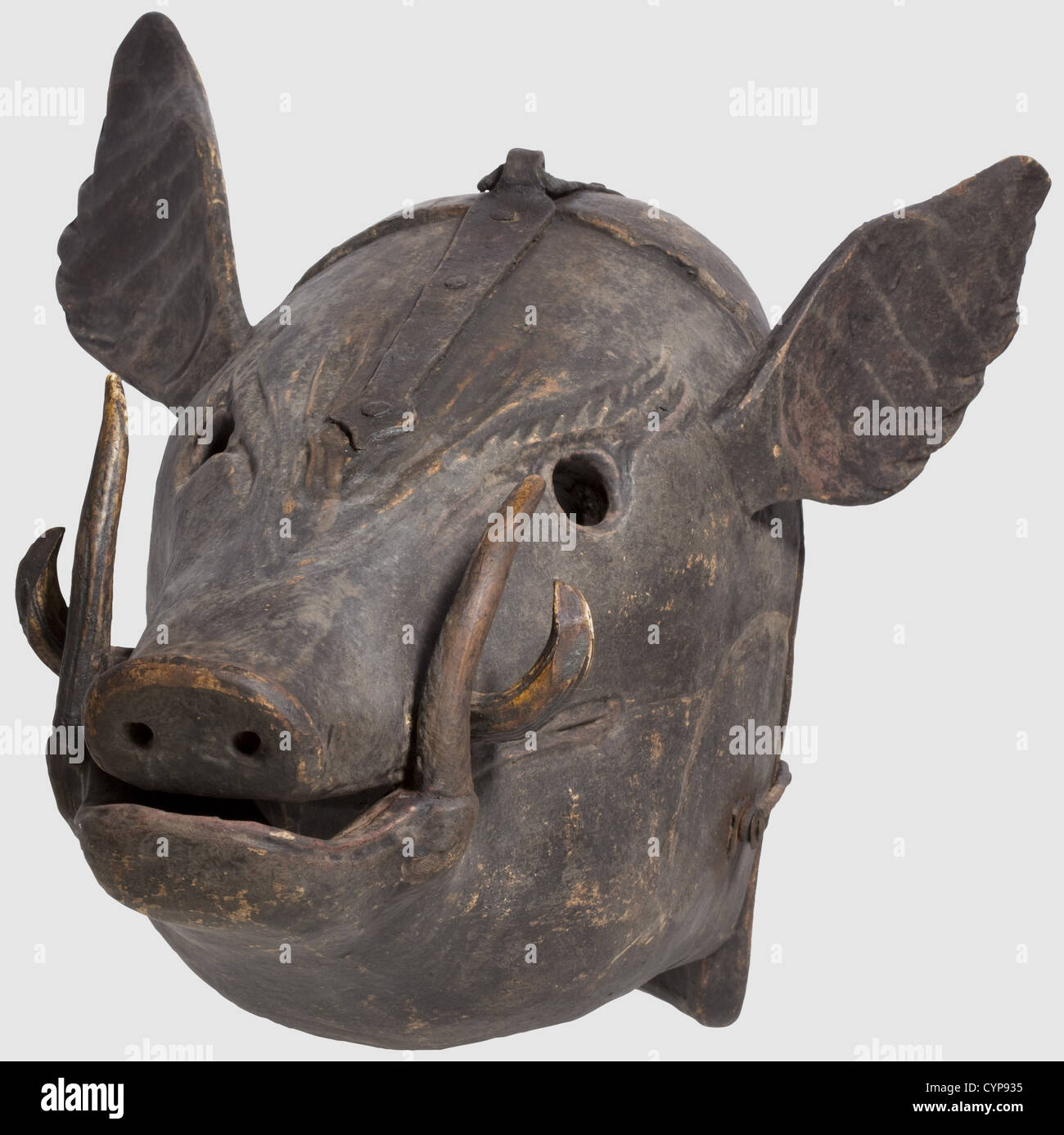 A German mask of shame, 17th/18th century. Carved wooden mask in the shape of a boar's head with inserted boar's - Stock Image