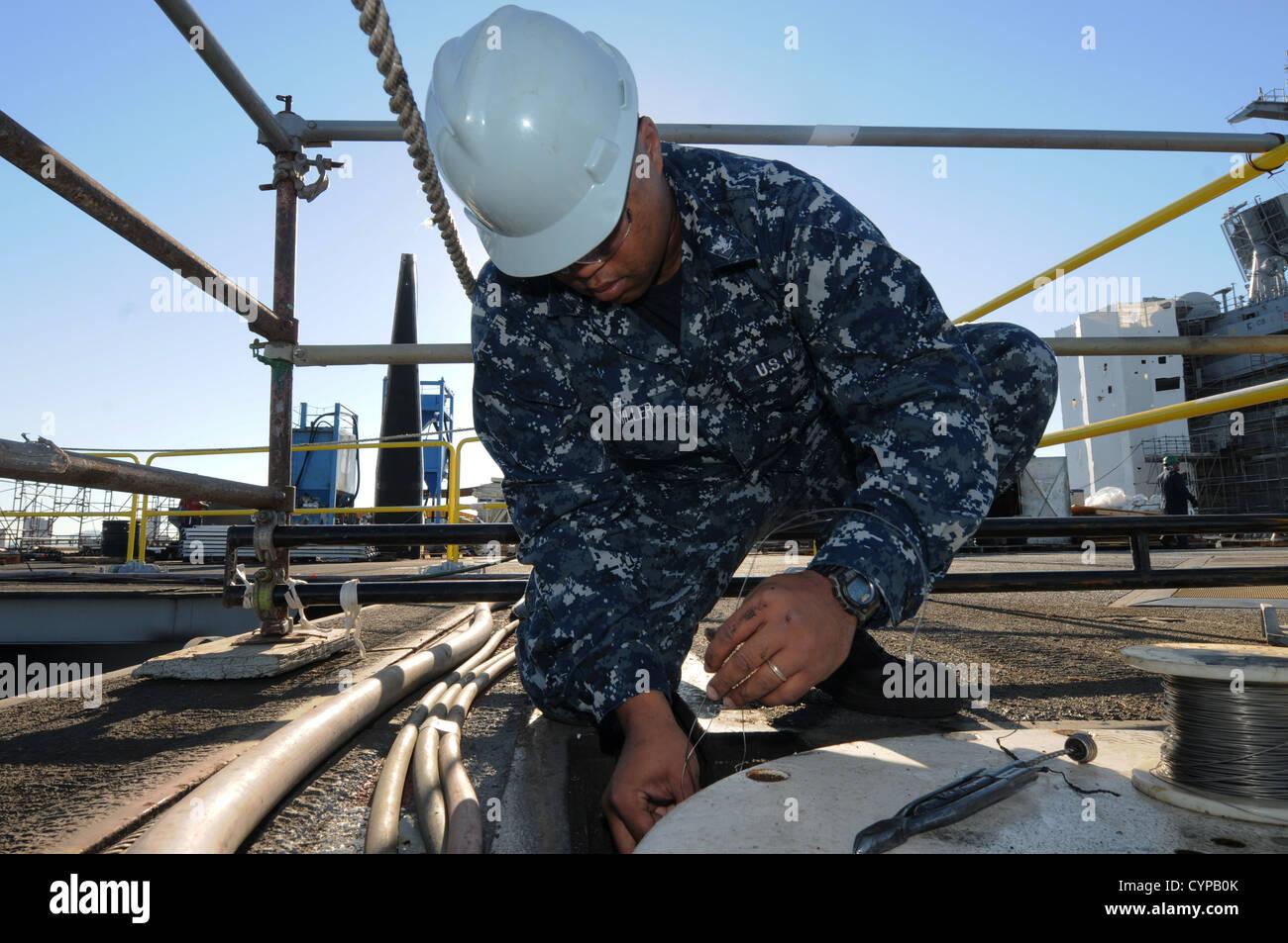 CORONADO, Calif. (Nov. 5, 2012) Aviation Boatswain's Mate (Equipment) Jermie Miller performs maintenance on - Stock Image