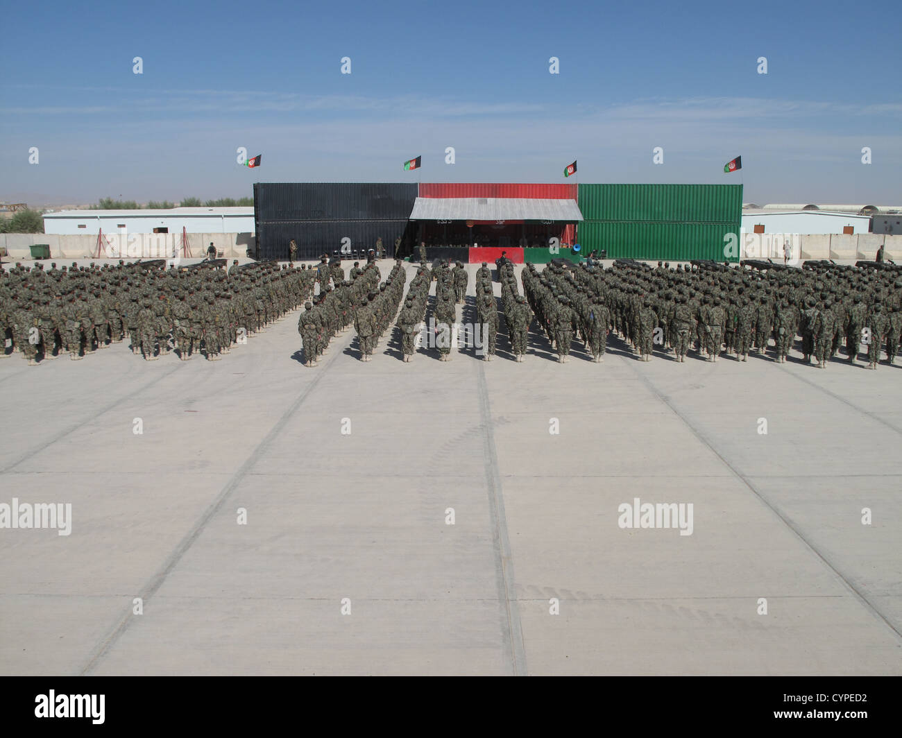 Standing at attention, more than 1,000 Afghan soldiers with 215th Maiwand Corps prepare to swear the Afghan Armys - Stock Image