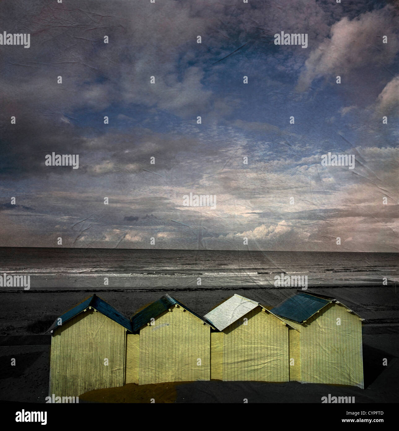Beach huts under a stormy sky, vintage-look, Normandy, France, Europe. Stock Photo