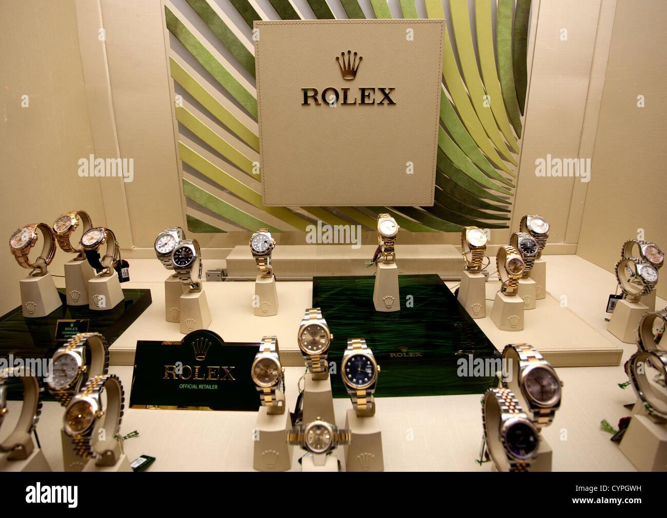London shop window display of luxury Rolex watches - Stock Image